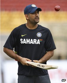 Indian cricket captain Mahendra Singh Dhoni tosses a ball during a training session in Bangalore, India, Wednesday, Aug. 29, 2012.
