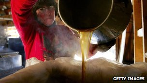 A woman pours maple syrup into a tank in Bowdoin, Maine (file image from 2006)