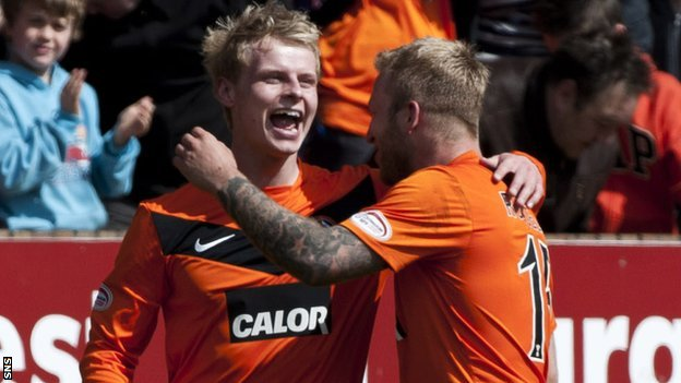 Gary Mackay-Steven and Johnny Russell celebrate with Dundee United