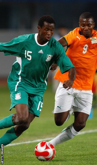 Ambrose (left) in action for Nigeria