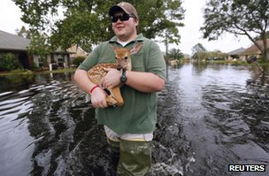 A state biologist rescues a fawn after Hurricane Isaac in La Place, Louisiana, on 31 August 2012