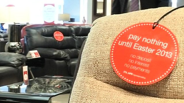 "Furniture in store with ""buy now pay later"" tags"