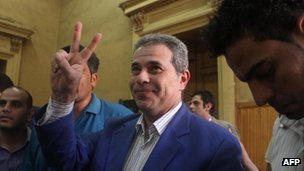 Tawfiq Ukasha gesturing as he arrives in court