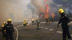 Firefighters try to extinguish a fire in a forest on the road between Marbella and Monda in Ojen, near Malaga, southern Spain August 31, 2012.