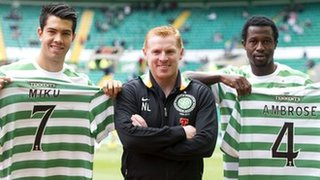 Celtic manager Neil Lennon is flanked by new signings Miku and Efe Ambrose