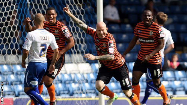 Lee Hughes celebrates his opener