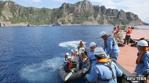 The city government of Tokyo's survey staff return to their survey vessel after examining around the disputed islands