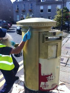 Post box being painted - pic by Steven Duff