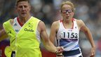 Great Britain's Tracey Hinton runs with her guide Steffan Hughes during the women's 200m T11 semifinal