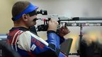 Richard Davies of Great Britain competes in the mixed R4-10m air rifle standing shooting SH2