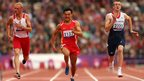 Marcin Mielczarek of Poland, Mian Che of China and Ben Rushgrove of Great Britain compete in the men's 100m T36 heats at the Olympic Stadium
