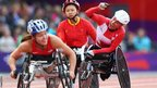 Edith Wolf of Switzerland celebrates winning gold in the women's 5000m T54 final