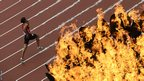 Tunisia's Farhat Mohamed Chida runs along the first bend beneath the cauldron during the men's 400 metres T38 race