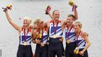 Britain's Pamela Relph, Naomi Riches, Davis Smith, James Roe and Lily van den Broecke celebrate on the podium after they win gold in the rowing LTA mixed coxed four at Eton Dorney