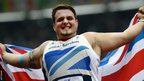 Great Britain's Aled Davies holds the Union flag after winning gold in the men's discus throw F32 category