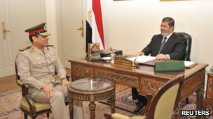Egypt's President Mohamed Mursi meets with Defence Minister General Abdel Fattah al-Sisi in Cairo on 22 August