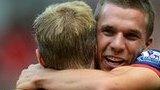 Lukas Podolski celebrates Arsenal's opening goal