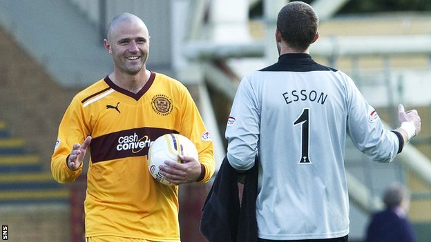 Motherwell forward Michael Higdon and Inverness goalkeeper Ryan Esson