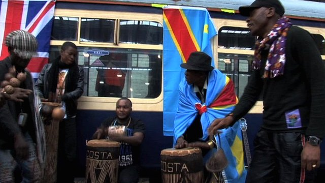 Musicians in front of the Africa Express train