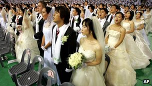 Mass wedding ceremony arranged by the Unification Church  in Cheonan, South Korea, in August 2005
