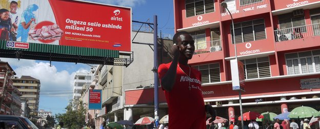 Tanzanian man with mobile phone in Dar es Salaam