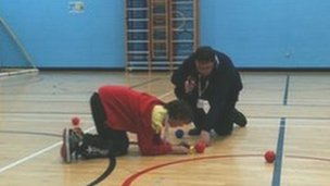 Pupils from John Grant School measuring the distance of the balls from the jack during a game of Boccia