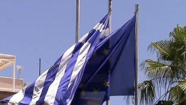 Greek and EU flags