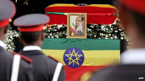 "Soldiers stand in front of the coffin of Ethiopia""s late Prime Minister Meles Zenawi as people attend his official state funeral on September 2, 2012, in Addis Ababa under banners with picture."