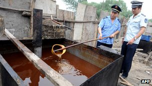 File photo: Police inspecting illegal cooking oil seized in 2010