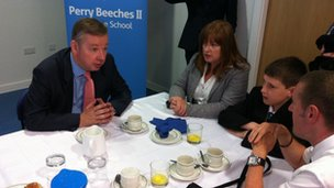 Michael Gove with Perry Beeches II parents and pupil