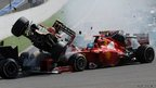 Romain Grosjean passes over the top of Fernando Alonso's Ferrari at Spa