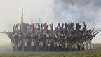 Participants in period costume re-enact the battle of Borodino