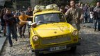 Spectators push a Trabant car in Prague.