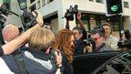 Former News International boss Rebekah Brooks is surrounded by photographers as she leaves court