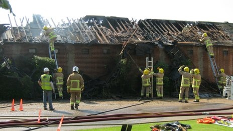 Fire crews tackling the fire at Luca Cumani's stables in Newmarket