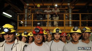 Miners at Italy's Carbosulcis coal mine in Sardinia on 29 August 2012