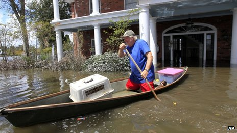 Don Duplantier paddles a pirogue from his flooded home as floodwaters from Hurricane Isaac recede in Braithwaite, Louisiana, on 2 September 2012
