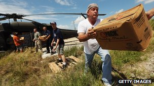 Volunteer Fire Department Chief Dale Scarabin (R) helps unload meals delivered by the US Army in lower Plaquemines Parish on 2 September 2012
