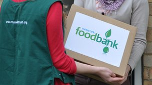 A Trussell Trust volunteer handing out food