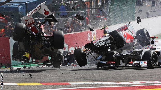 Fernando Alonso (left) and Lewis Hamilton (right) collide and crash out at the first corner at the start of the Belgian Grand Prix