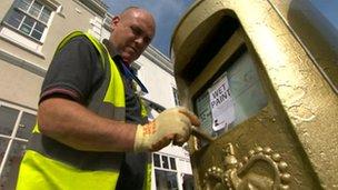 Gold postbox in Stratford upon Avon