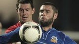 Portadown's Garry Breen in action against Glenavon player-manager Gary Hamilton