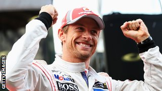 Jenson Button celebrates winning the Belgian Grand Prix