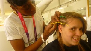 Amanda Fowler having her hair braided