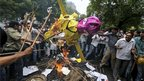 Opposition BJP members burn an effigy of PM Manmohan Singh as they protest against the government&#039;s sale of coal fields without competitive bidding in Delhi on 29 August 2012 