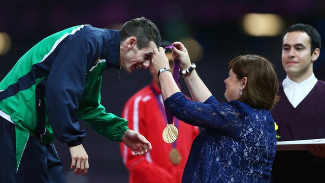 Michael McKillop is presented with his T37 1500m gold medal by his mother Catherine