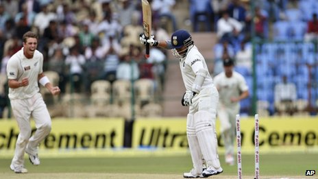 India&quot;s batsman Sachin Tendulkar reacts after he is bowled out by New Zealand bowler Tim Southee, left, during the fourth day of their second cricket test match in Bangalore, India, Monday, Sept. 3, 2012