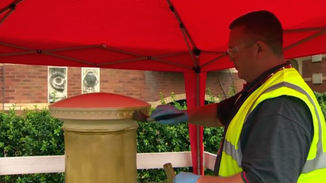 The postbox on Trawler Road at Swansea marina has been painted gold