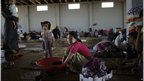 Girl washing laundry at the Bab Al-Salameh crossing (3/09/12)