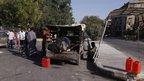 Truck selling gasoline by the roadside